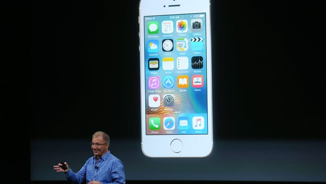 Apple VP Greg Joswiak announces the new iPhone SE during an Apple special event at the Apple headquarters on March 21, 2016 in Cupertino, California.