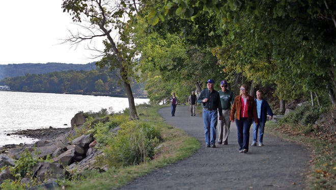 People walk along the Hook Mountain/Nyack Beach State Park along the Hudson River.