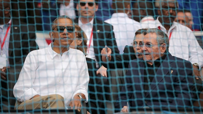U.S. President Barack Obama and Cuban President Raul Castro await the start of a baseball game between the Cuban national team and the Tampa Bay Rays at the Estado Latinoamericano March 22, 2016, in Havana, Cuba.