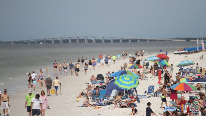 Spring breakers of all ages gathered on Fort Myers Beach on Friday for sun and fun.