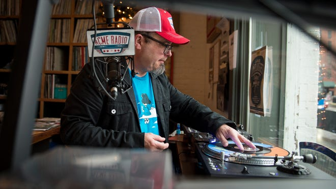 """Tim Hibbs, DJ of """"Vinyl Lunch,"""" places a record on the turntable at Acme Radio, Thursday, March 24, 2016, in Nashville, Tenn."""