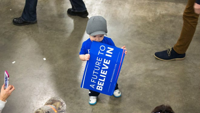 Nineteen-month-old Craig Fietzer waits with his mother for the arrival of Democratic presidential candidate Senator Bernie Sanders (D-VT) at a campaign rally in Madison, Wis., on Saturday.