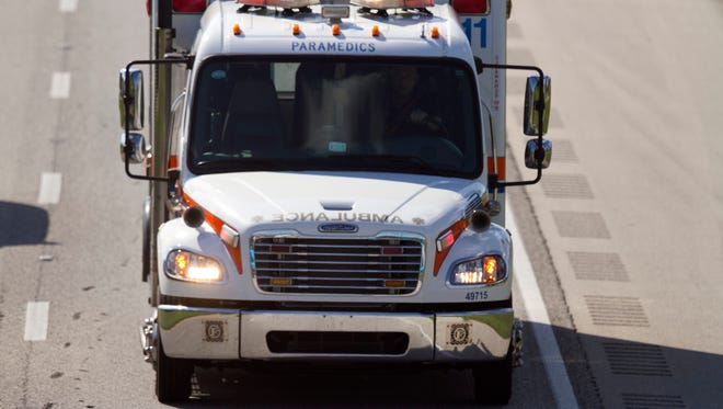An ambulance drives north in the southbound lanes on Interstate 75 on Thursday. Shortly before, Lee County Sheriff's deputies apprehended a suspect who fled a traffic stop.