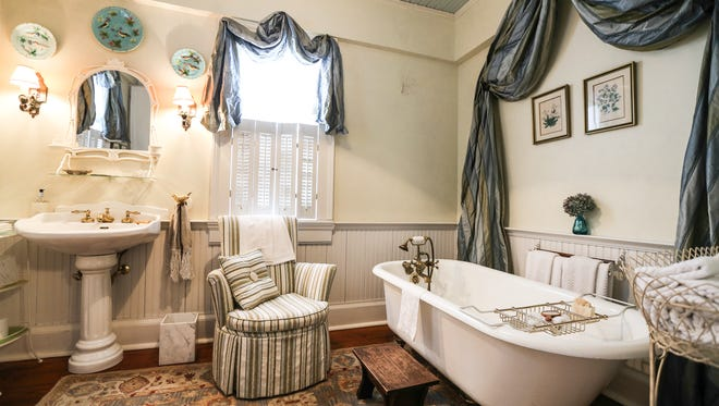 Downstairs bathroom.  All elements of this bathroom have been added by Jim and Barbara.  The claw-foot tub is more than 100 years old but is not original to this home.  In original photos of the home this was the side porch of the house. March 23, 2016