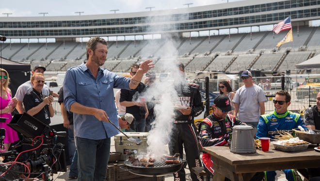 Blake Shelton, center, on the set of a NASCAR on NBC shoot Thursday at Texas Motor Speedwa.