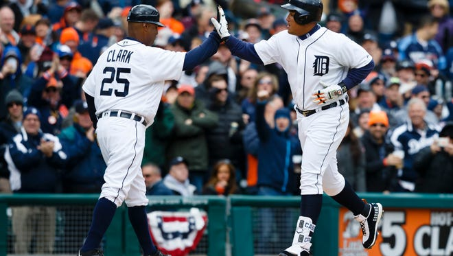 Apr 8, 2016; Detroit, MI, USA; Detroit Tigers first baseman Miguel Cabrera (24) receives congratulations from third base coach Dave Clark (25) after he hit a home run in the seventh inning against the New York Yankees at Comerica Park. Mandatory Credit: Rick Osentoski-USA TODAY Sports
