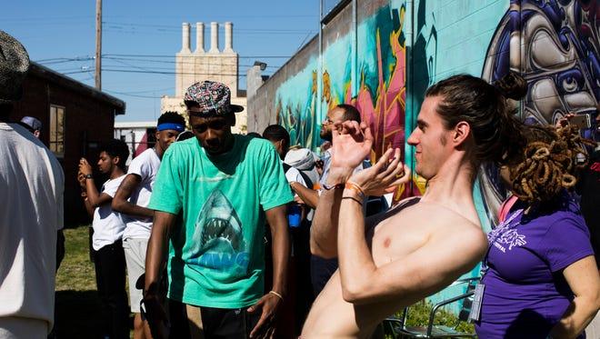 Spectators dance at the LouiEvolve Hip Hop and Arts Festival.