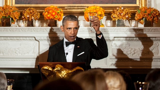 President Barack Obama gives a toast during a National Governors Association dinner and reception in the State Dining Room of the White House February 21, 2016 in Washington, D.C.