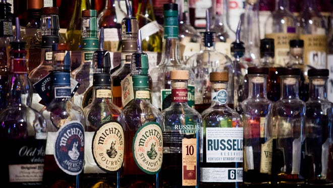 Hundreds of bottles are on display behind the bar.