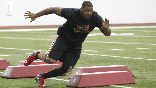 University of Louisville's Sheldon Rankins runs through football drills during the UofL Pro Football Day at the Trager Center in Louisville, Kentucky.       March 9, 2016