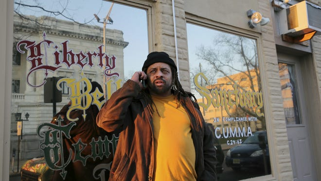 Ed 'NJ Weedman' Forchion stands in front of Weedman's Joint and Liberty Bell Temple III in Trenton. His business license was revoked in September