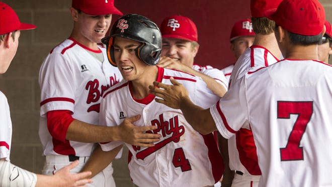 Brophy's Mitchell Anderson celebrates with teammates after scoring against Boulder Creek in the 5th inning on Saturday, Apr. 30, 2016 at Brophy College Preparatory in Phoenix. Brophy won, 5-2.