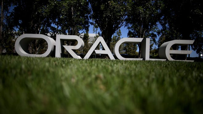 The Oracle logo is displayed in front of the Oracle headquarters on June 19, 2014 in Redwood Shores, California.