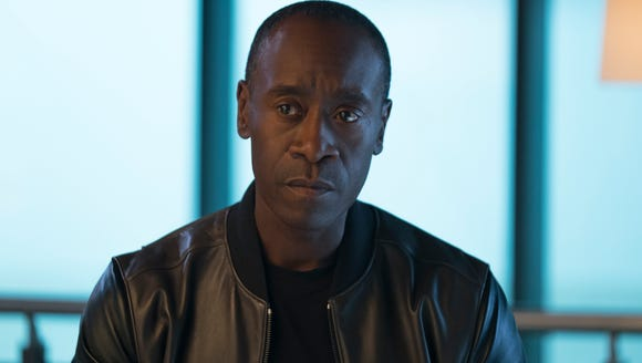 "James Rhodes (Don Cheadle) finds it difficult to toe the line between Avengers and government duty in ""Captain America: Civil War."" (Photo: ZADE ROSENTHAL)"