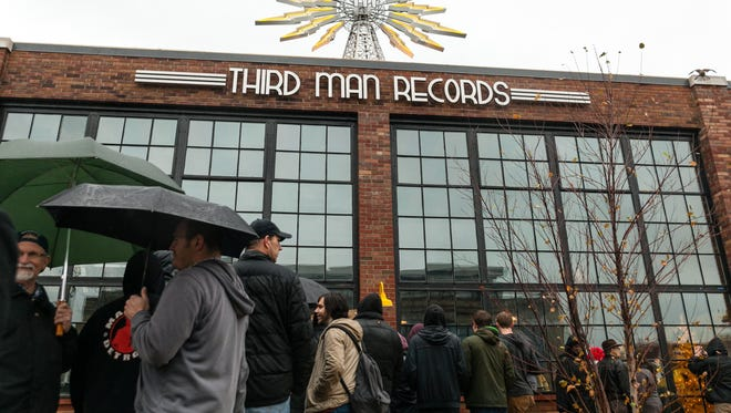 Hundreds of fans waited in the rain for their chance to attend the grand opening festivities at Third Man Records in Detroit.