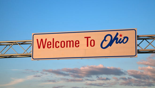 A file photo of a sign welcoming visitors to Ohio