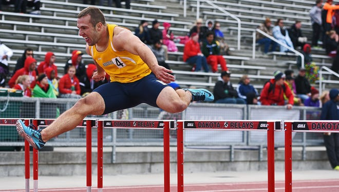 Augustana's Jason Greenway (4) runs in the men's 400-meter hurdles during the 2016 NSIC Outdoor Track and Field Championships on Saturday at Howard Wood Field in Sioux Falls.