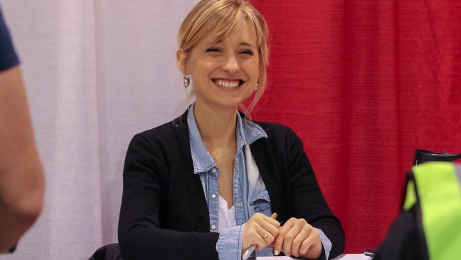 """Actress Allison Mack, form the television series """"Smallville,"""" greets guests at the Suburban Collection Showplace in Novi on Saturday May 14, 2016 during the Motor City Comic Con."""