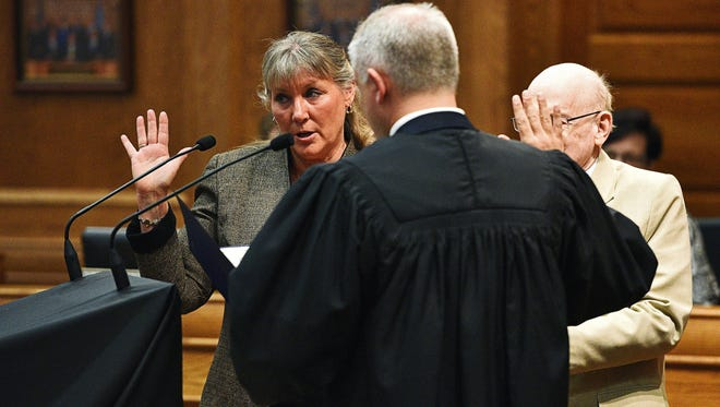 Theresa Stehly, a Sioux Falls City Council Member, is sworn in by Judge John Pekas as former City Council Member Kermit Staggers looks on during a Sioux Falls City Council Installation Ceremony Tuesday, May 17, 2016, at the Carnegie Town Hall in downtown Sioux Falls.