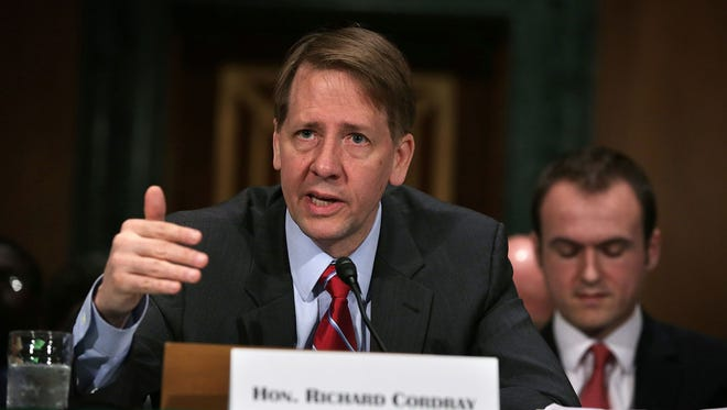 Richard Cordray, director of the Consumer Financial Protection Bureau, testifies at a hearing by the Senate Banking, Housing and Urban Affairs Committee.