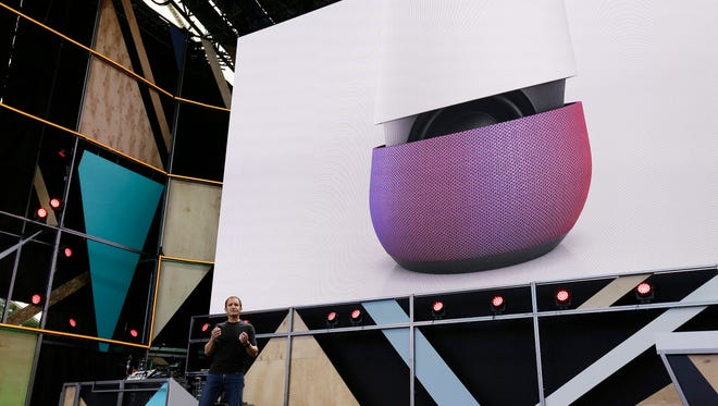 Google vice president Mario Queiroz gestures while introducing the new Google Home device during the keynote address of the Google I/O conference