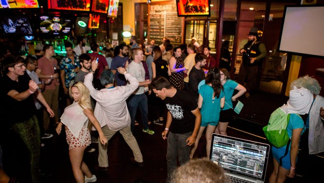 Patrons dance at one of the last parties at Endgame in Tempe, which will close on May 28.