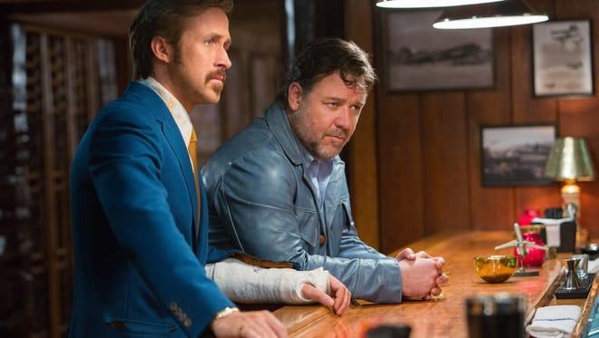 "Ryan Gosling, left, and Russell Crowe in a scene from ""The Nice Guys."""