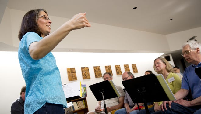 Program director Karen McFeeters Leary leads a rehearsal of the Aphasia Choir, made up of stroke survivors and others who have a communication disability.  The program is based at the Fanny Allen campus of the UVM Medical Center in Colchester.