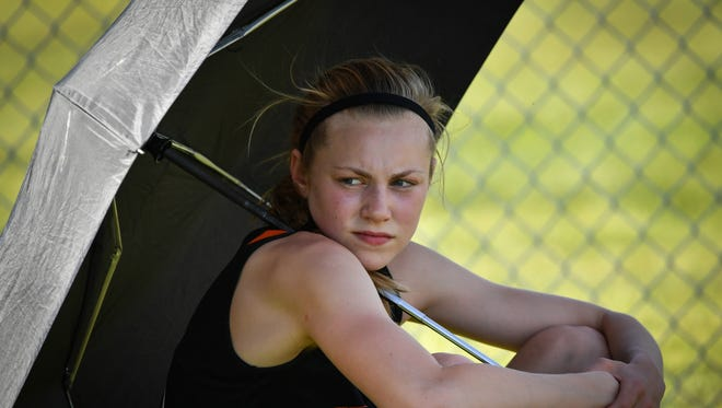Faith Lubner, of Reedsville, uses an umbrella to stay cool before her turn in the long jump.The 2016 Princeton Track and Field Sectional was held May 26.