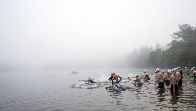 The second wave of competitors takes off into Biltmore Lake for the first leg of the Enka Triathlon last year. The ninth annual triathlon with a 750-meter open-water swim, 17.5-mile bike ride and a 5K-run is June 18.