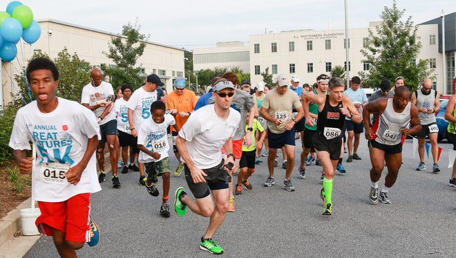 A Superhero 5K will help raise funds for the Boys & Girls Club of Greenville County. In this file photo, Josh Moore (015) starts and finishes first during the Great Futures 5K Kroc Center to raise critical funds for The Salvation Army Boys & Girls Club of Greenville County  Saturday August 15, 2015