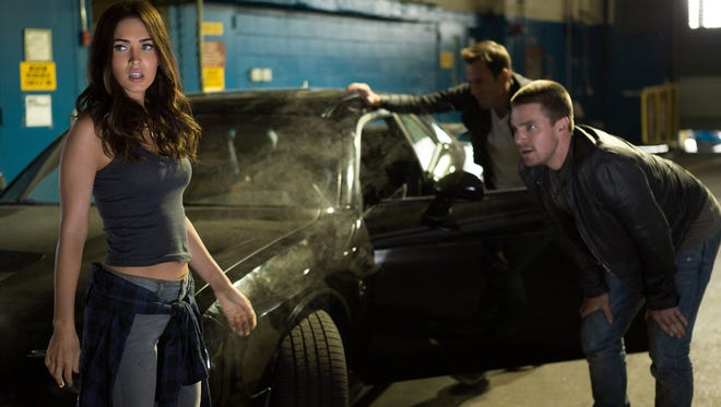 April O'Neil (Megan Fox), with Vern Fenwick (Will Arnett) and Casey Jones (Stephen Amell) is the least appealing character in 'Teenage Mutant Ninja Turtles: Out of the Shadows.'