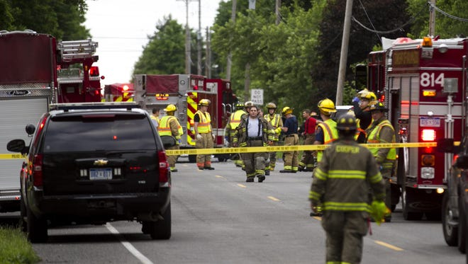 Police and rescue workers attend to the scene after multiple bicyclists were struck by a vehicle in a deadly crash Tuesday, June 7, 2016, in Cooper Township, Mich.