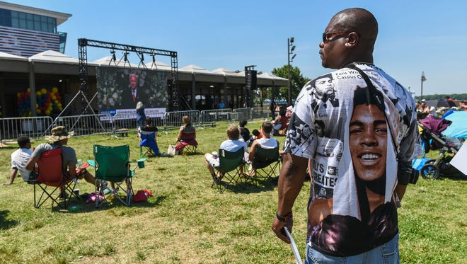 Antonio Williams watches the Muhammad Ali funeral service screened on a jumbotron on the Belvedere. June 10, 2016