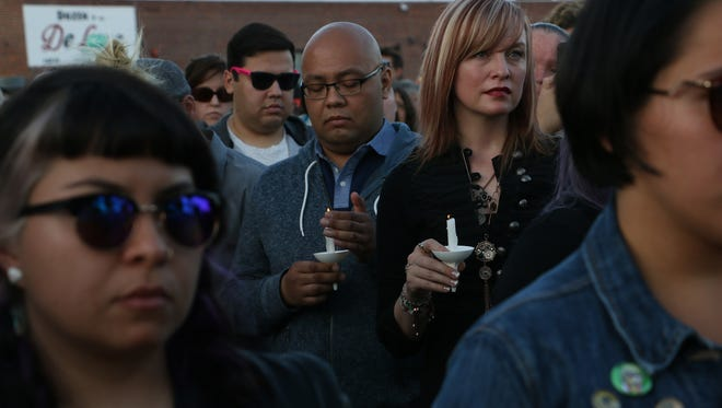 Hundreds gather during a public candlelight vigil to honor the victims of the Orlando nightclub shooting at OUR Center, northern Nevada's LGBTQ community center, in Reno on June 12, 2016.