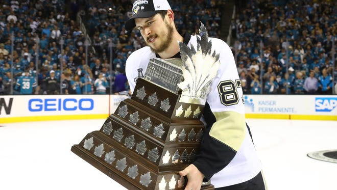 Sidney Crosby #87 of the Pittsburgh Penguins celebrates being awarded the Conn Smythe after their 3-1 victory to win the Stanley Cup against the San Jose Sharks in Game Six of the 2016 NHL Stanley Cup Final at SAP Center.