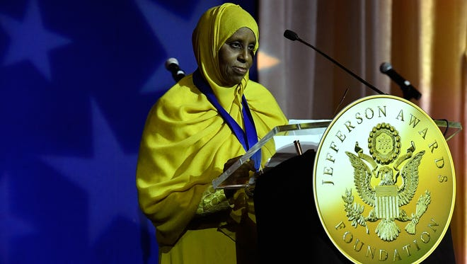 Sadiya Omar of Rochester accepts the Jacqueline Kennedy Onassis Award for Outstanding Public Service Benefiting Local Communities at the Jefferson Awards Foundation ceremony on Thursday in Washington, D.C.