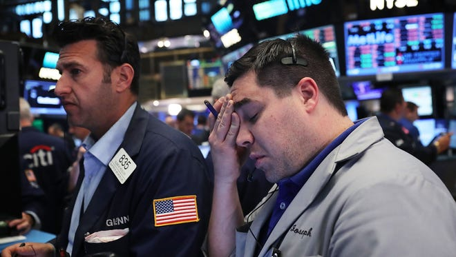 Traders work on the floor of the New York Stock Exchange following news that the United Kingdom has voted to leave the European Union. Major market indices in the U.S. fell sharply again Monday.