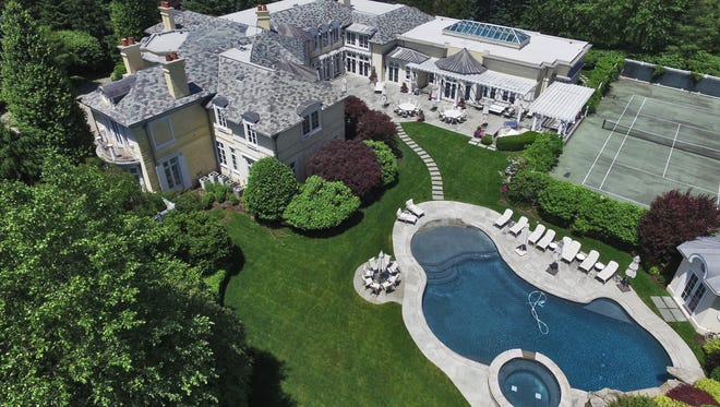 The Stark Estate in Alpine is a 25-acre estate with nine bedrooms, an indoor pool and basketball court, an outdoor tennis court, outdoor pool and poolhouse and much more. It's offered at $20 million.
