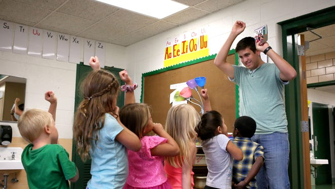 Teacher Brad Green, right,  instructs students to line up during the Begindergarten program at Green Valley Elementary. July 7, 2016