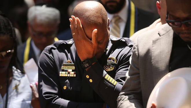 Dallas Police Chief David Brown pauses at a prayer vigil after the deaths of five police officers during a Black Lives Matter march in Dallas.