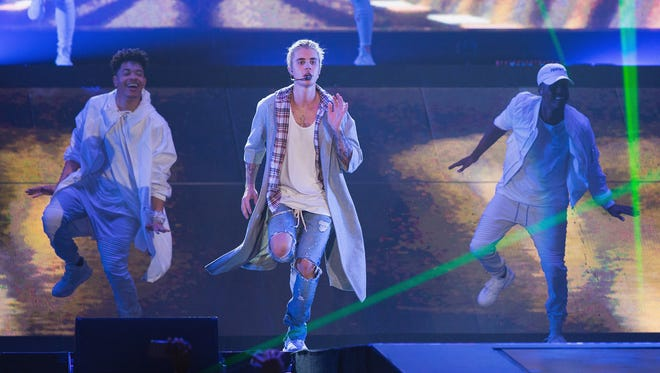 Justin Bieber on stage during opening night of the 'Purpose World Tour' at KeyArena on March 9, 2016 in Seattle, Washington.