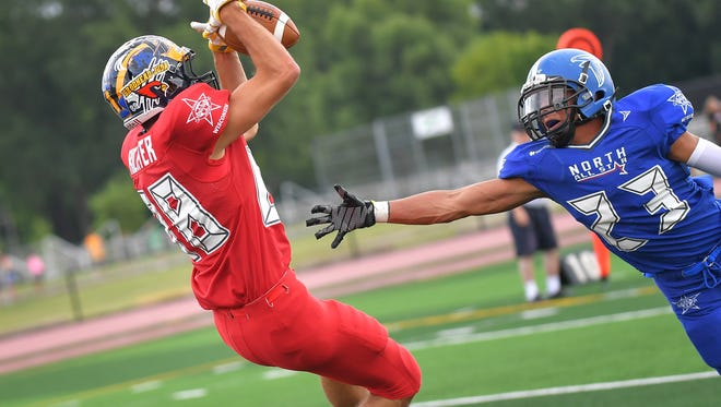 Michael Richter (88) of Ozaukee hauls in a touchdown catch behind North's Amaziah McCall (23) of Amherst during the WFCA Small School All-Star game in Oshkosh on Saturday.