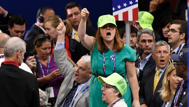 Members of the Virginia rebel against rules requiring them to vote for Donald Trump on the first ballot at the Republican National Convention, July 18.