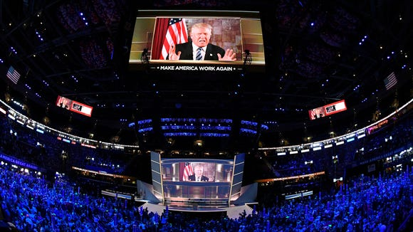 Donald Trump speaks via video from New York during