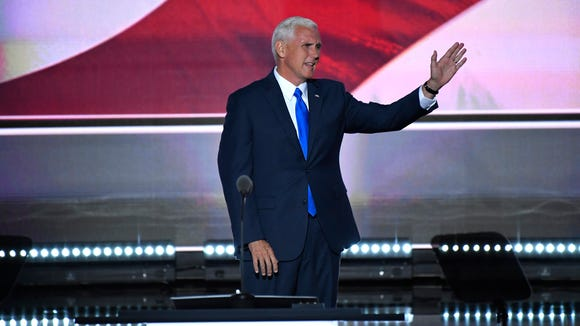 Indiana Gov. Mike Pence acknowledges the audience after
