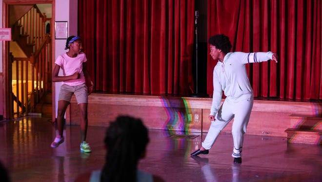 """Tiffanie Floyd, left, and Ja'Naye Flanagan perform as the Nicholas Brothers during rehearsal at Westwood Presbyterian Church.  They were performing """"Jumpin' Jive"""" as part of R.E.A.L. D.R.A.M.A.'s (Reality Enters At Levels you Decide Right Actions Matter Always) summer theatre Camp's tribute to the Harlem Renaissance """"Cotton Comes to Louisville""""."""