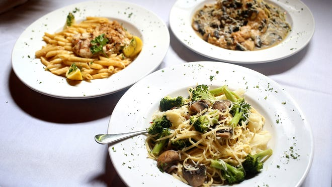 Broccoli, cauliflower, and mushroom pasta, front, grilled grouper, left, and chicken piccata, back right, by Selena's at Willow Lake Tavern.