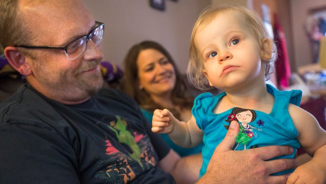 Andy Warywoda and his wife Jodie play with their youngest daughter Mabel at their home in Des Moines, Wednesday, Aug. 3, 2016. On his radio show, Warywoda recently shared an emotional testimony about the special needs his daughter requires which has resonated with the community.