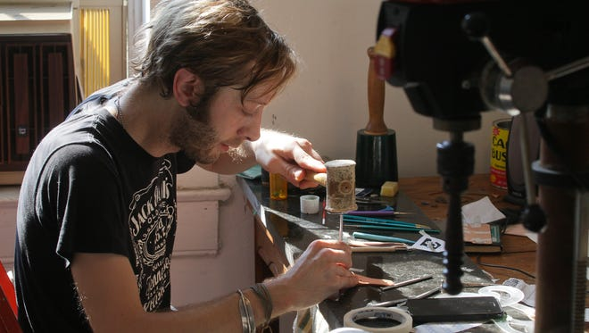 Leather craftsman Oscar Parsons, owner of Foak Leather, at work in his Schnitzelburg studio in Louisville, KY. Aug. 3, 2016